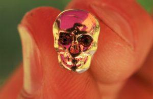 Petite tête de mort Or oeil violet