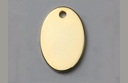 Médaille chien ovale dorée